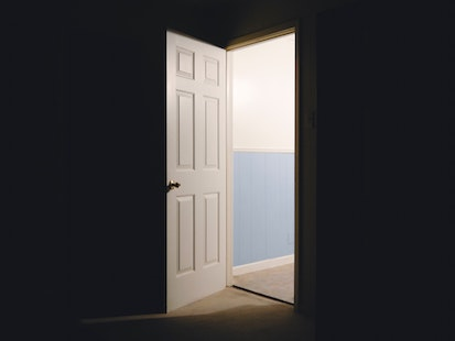 open door in dark room